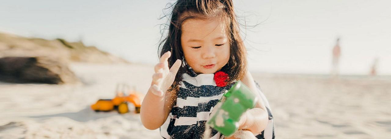 AptaGro girl play sand article