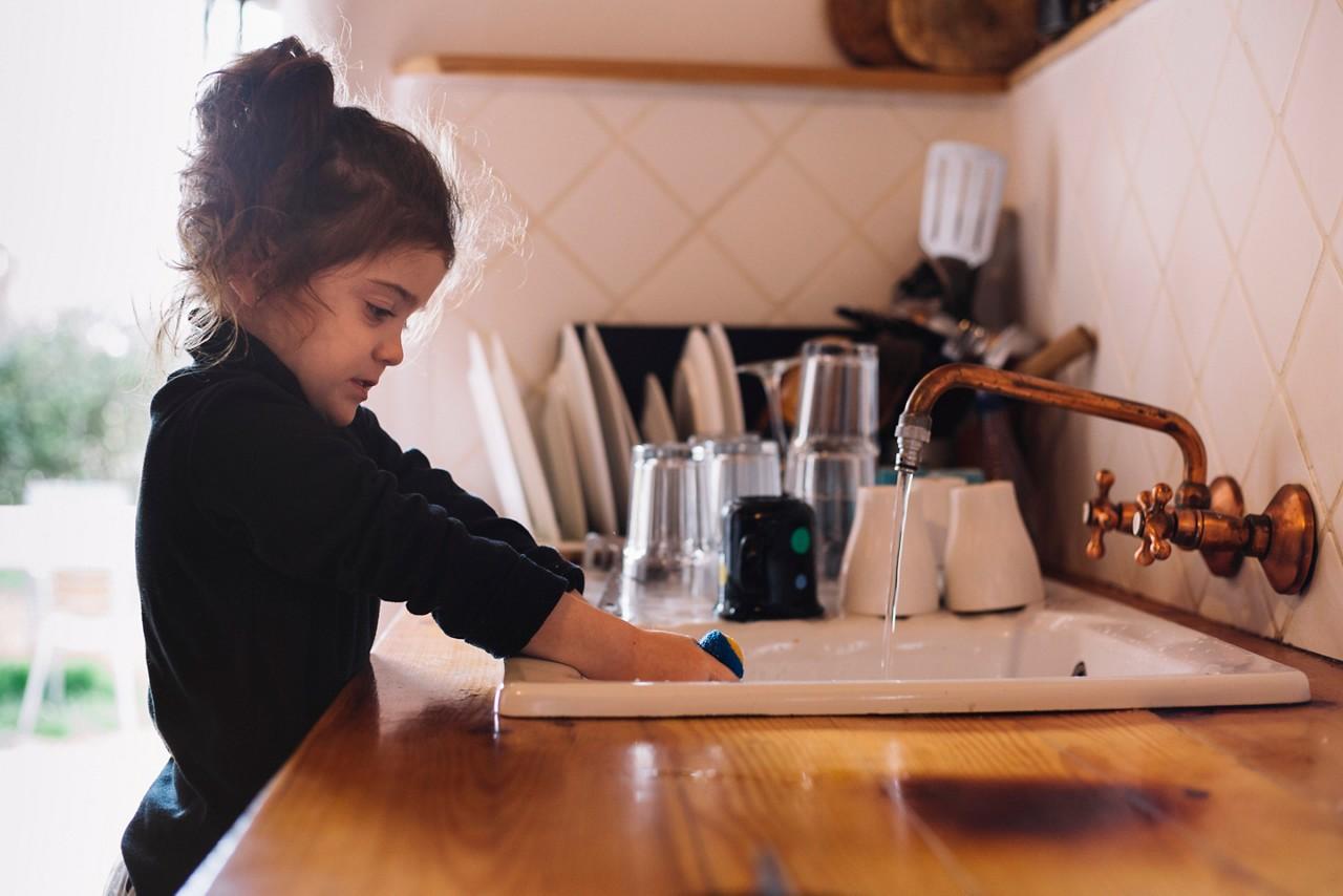 AptaGro girl washing dishes article website