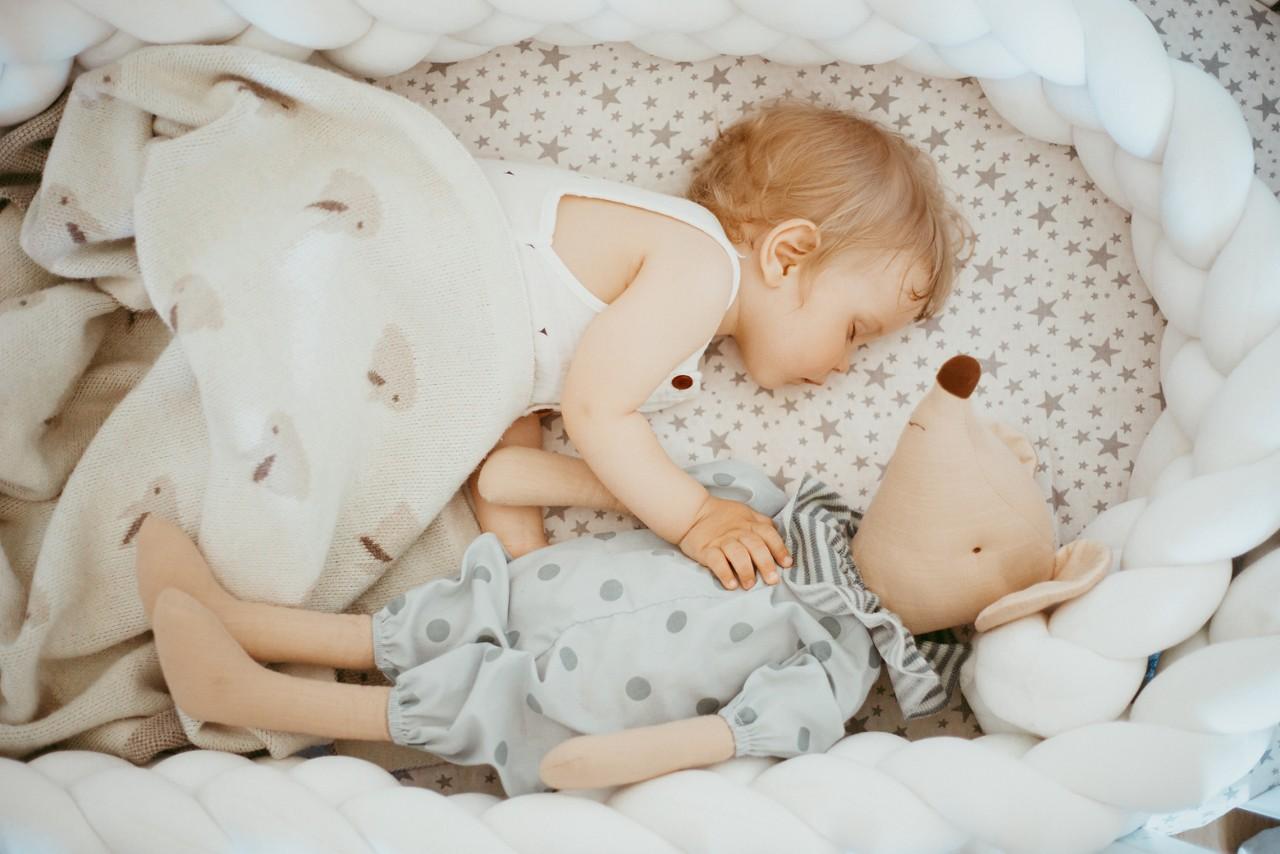 Baby sleeps with toy