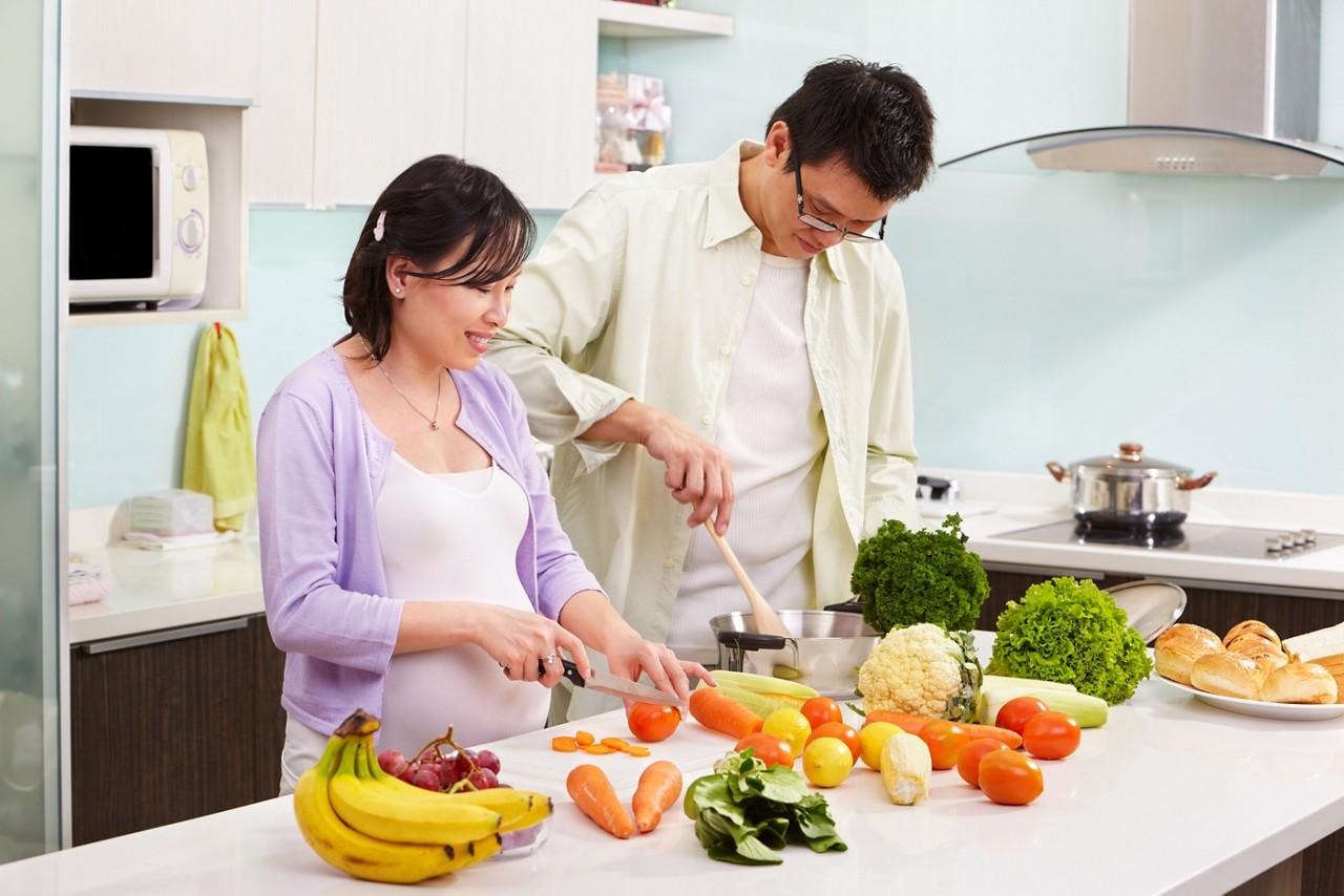 Couple kitchen prepare salad