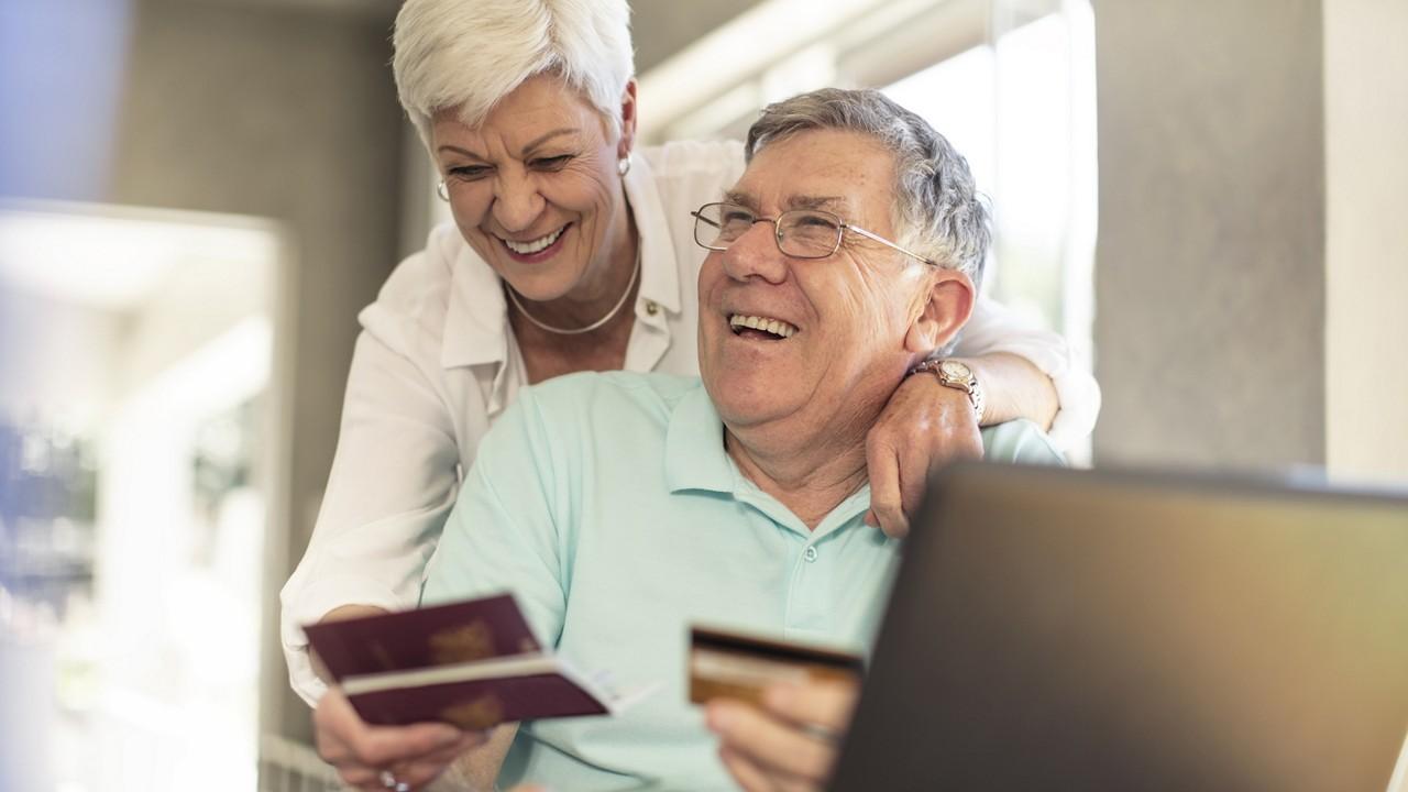 COVID-19 elderly couple laptop
