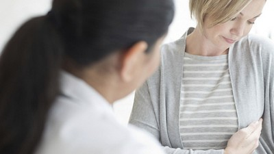 Doctor with female patient during consulation