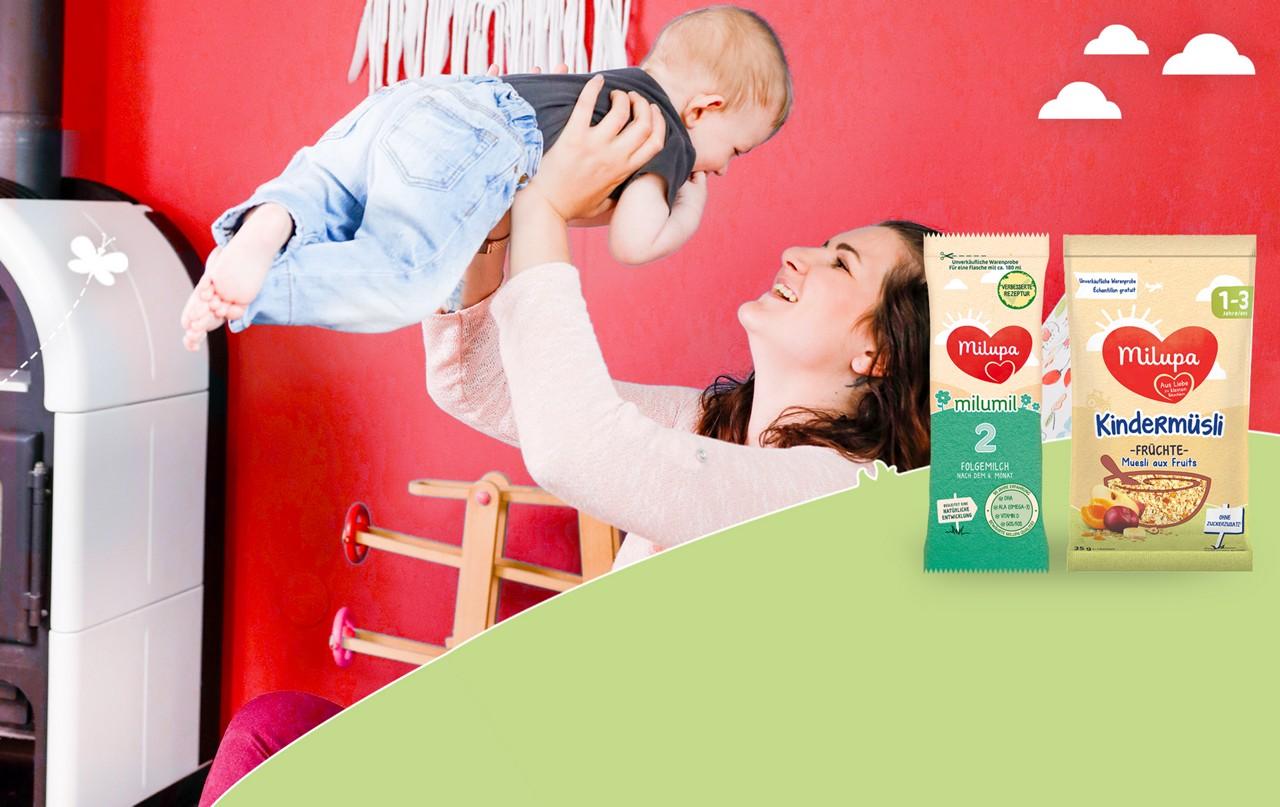 Mama mit Baby und Produktproben von Milupa