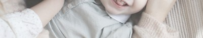 Mither kisses toddler FAQ banner 1