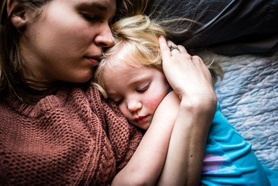 mother-with-sleeping-toddler