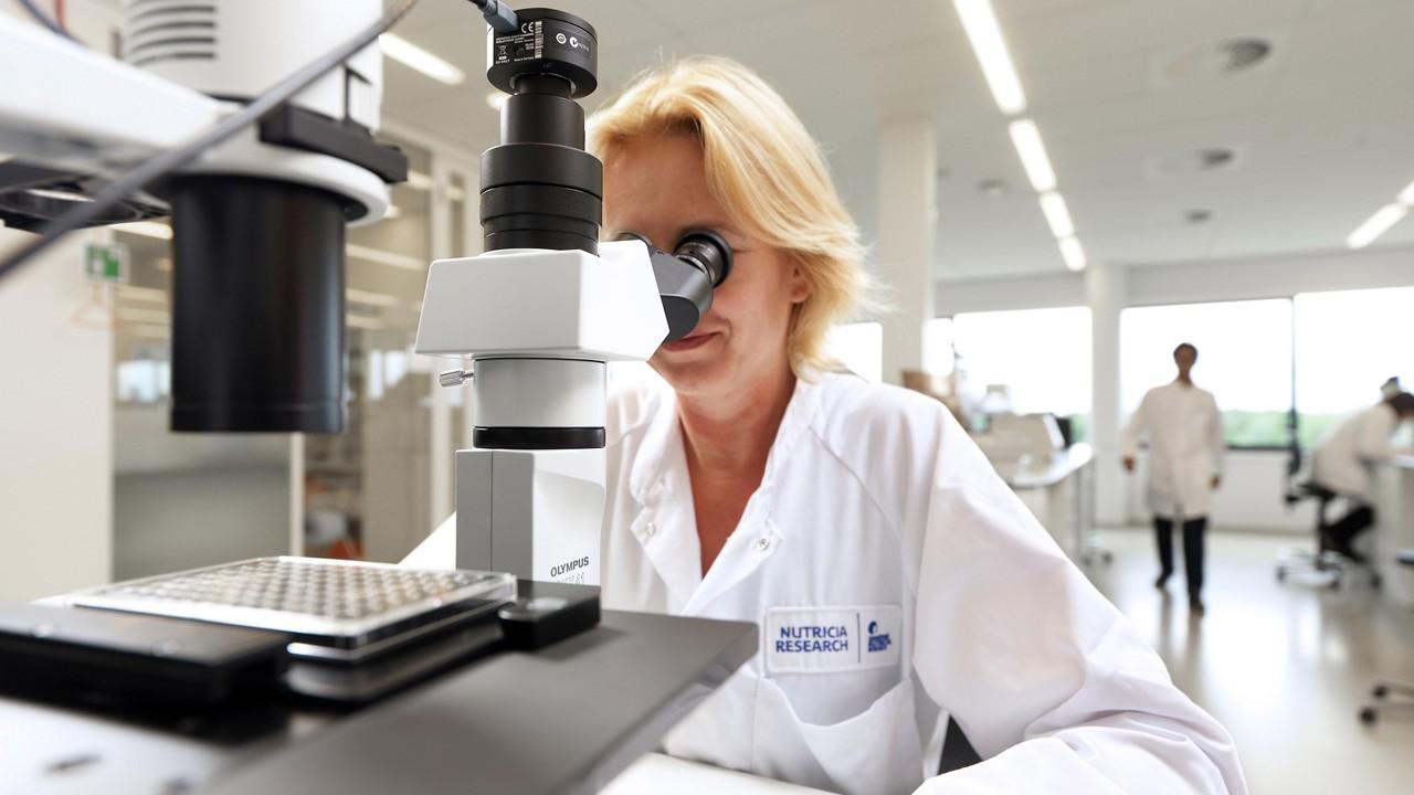 Nutricia utrecht scientist looking microscope
