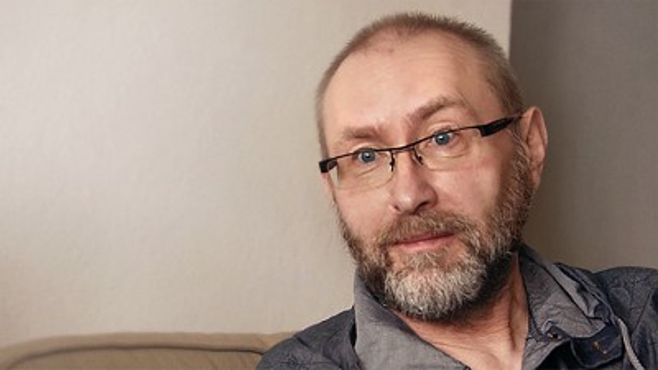 Oncology man sitting talking smaller