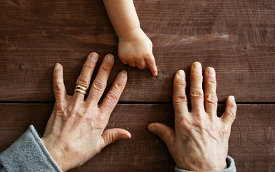 Young and old hands for adult covid info page