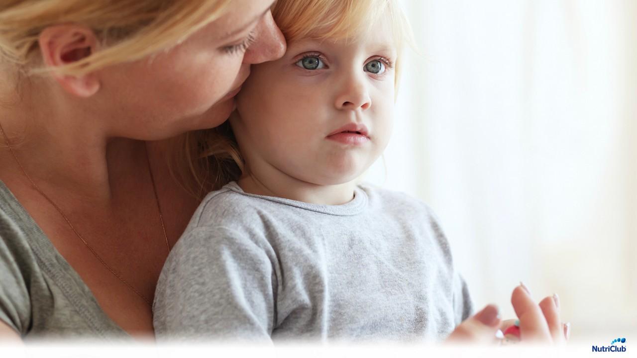 Mother talking to blonde toddler