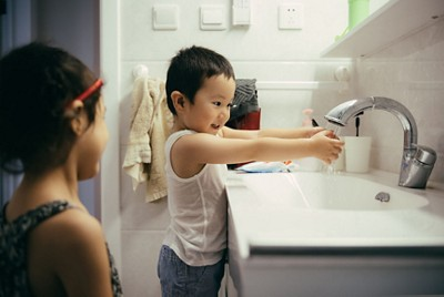 Little boy and girl washing hands