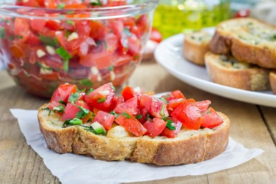 Bruschetta with tomatoes herbs and oil on toasted garlic cheese bread