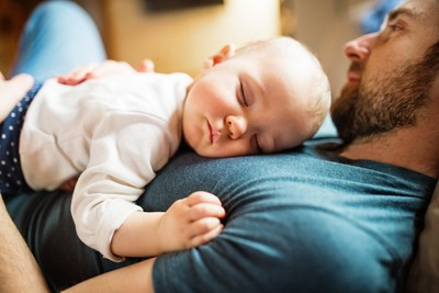 Father with sleeping baby