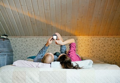 couple reading phone in bed