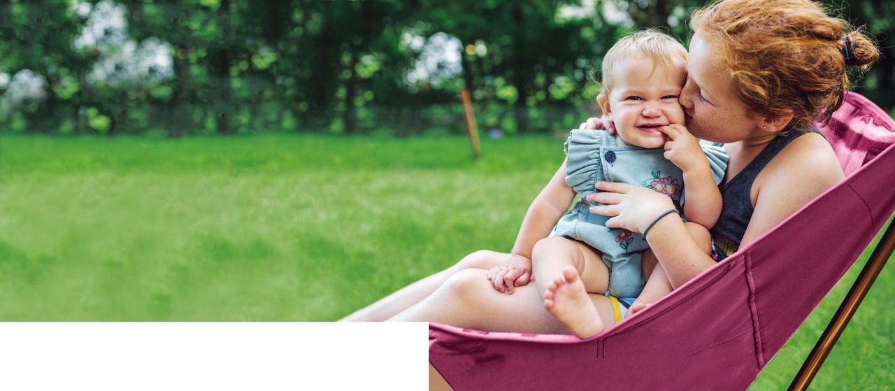 Mum baby in hammock outside