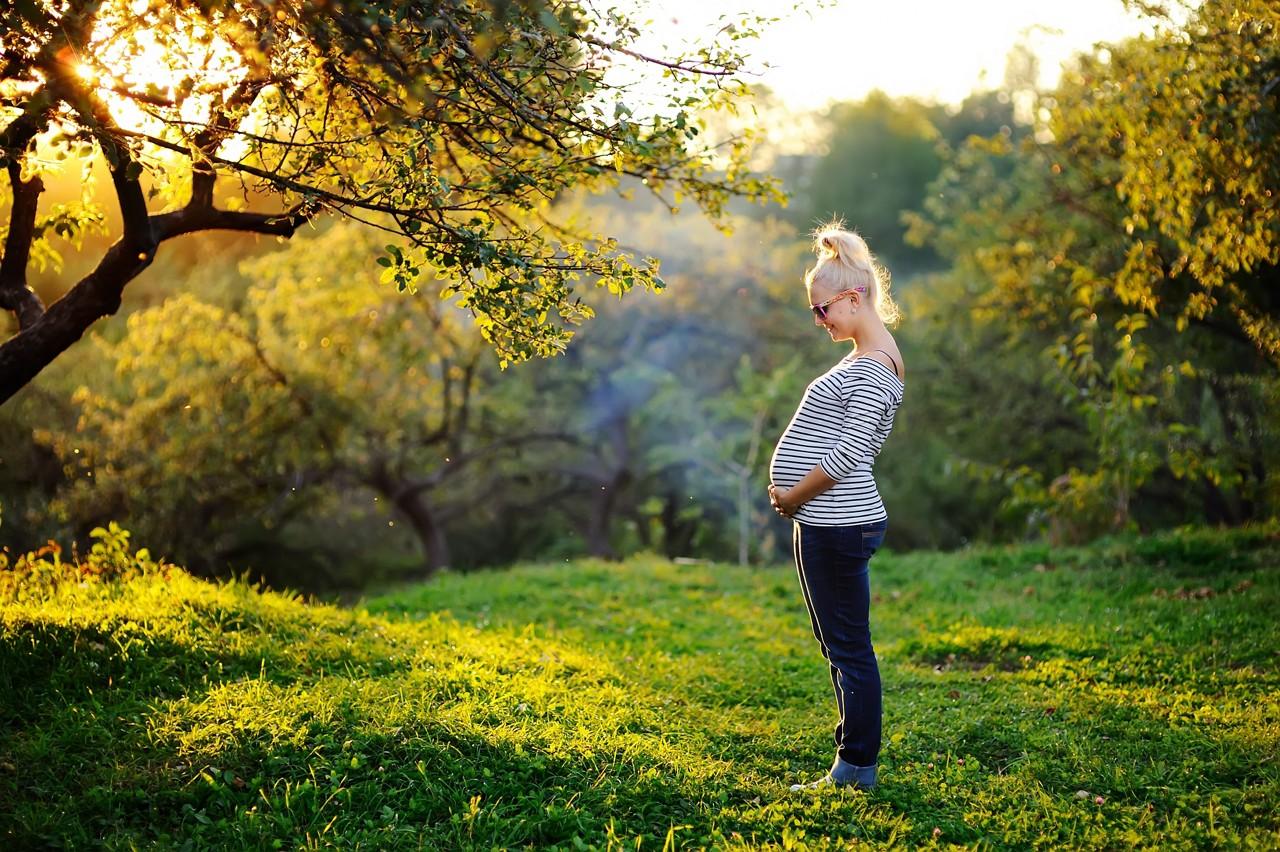 Pregnant woman outside sun