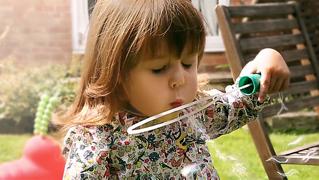 Little girl bubbles