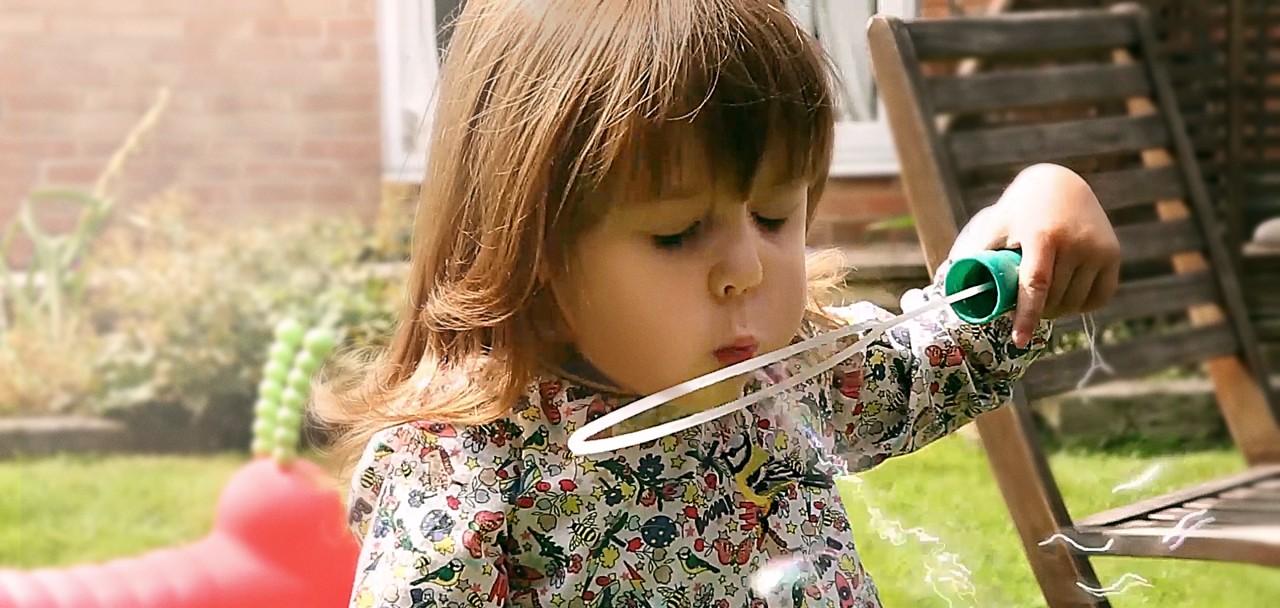 Preterm little girl bubbles