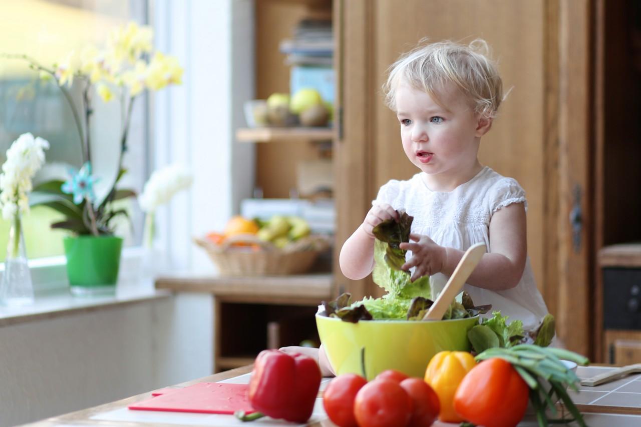 Toddler preparing vegetables