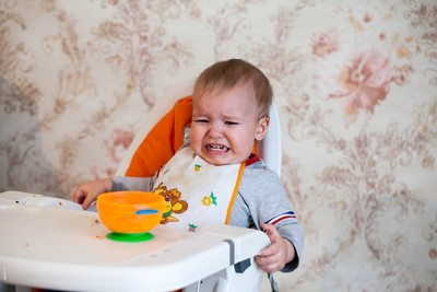 Unhappy baby crying highchair